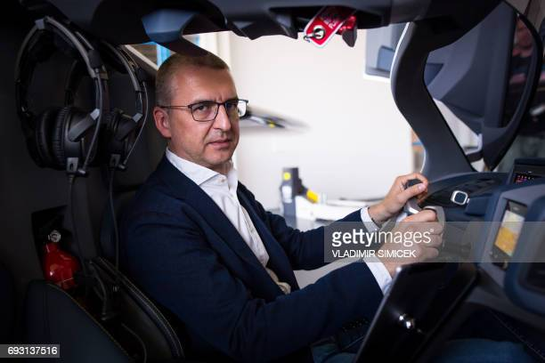 AeroMobil CEO Juraj Vaculik poses for a photo in a flying car AeroMobil during a media presentation in the headquarters of AeroMobil company in...