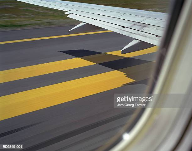 aeroplane about to take off, shadow of wing on runway - taxiing stock pictures, royalty-free photos & images