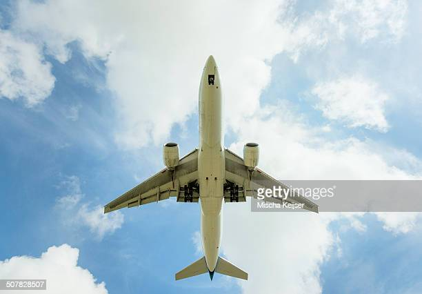 Aeroplane approaching Amsterdam Airport Schiphol, viewed from below