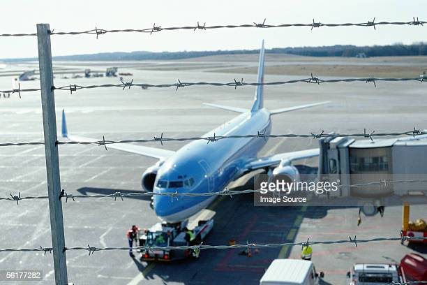 aeroplane behind barbed wire fence - exclusion stock pictures, royalty-free photos & images