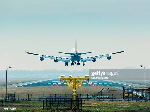 aeroplane coming in to land, amsterdam airport shiphol - landing gear stock photos and pictures