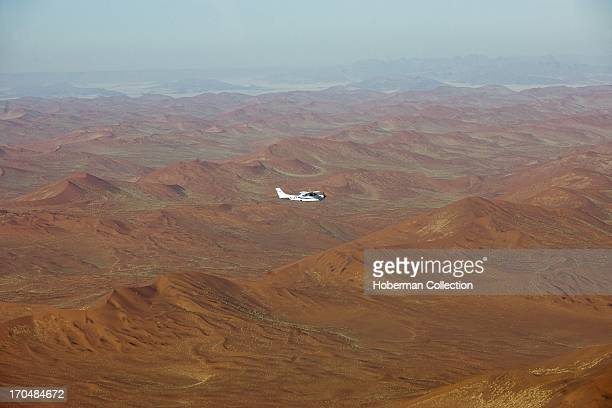 Aeroplane flying over desert landscape