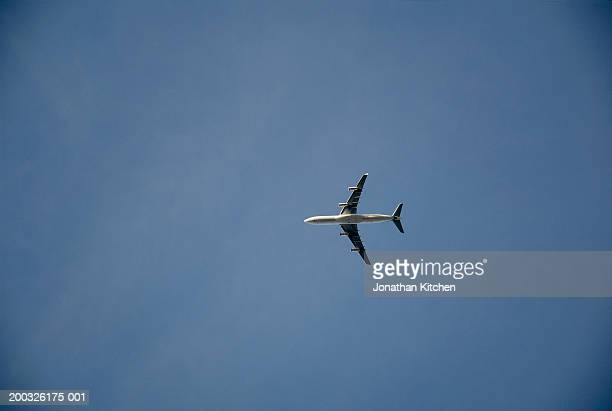 aeroplane in flight, low angle view - airplane tail stock pictures, royalty-free photos & images