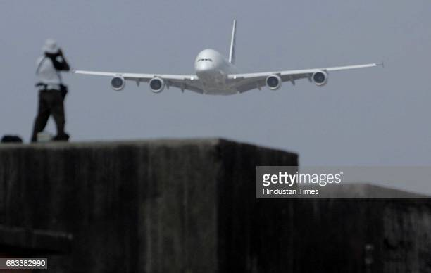 Aeroplane Mumbai Airport A Photographer takes pictures of the Airbus A380 on its arrival at the Chhatrapati Shivaji International Airport Mumbai...