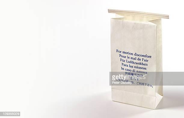 aeroplane sick bag - sick bag stock photos and pictures