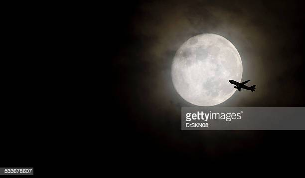 aeroplane silhouette near moon in night - mini moon stock pictures, royalty-free photos & images