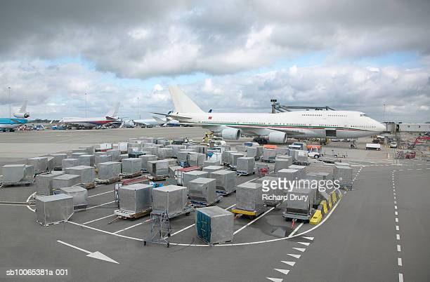 Aeroplane with containers on tarmac