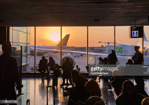 Aeroplanes and passengers at the terminal and gates of Frankfurt International Airport on October 15 2019 in Frankfurt Germany