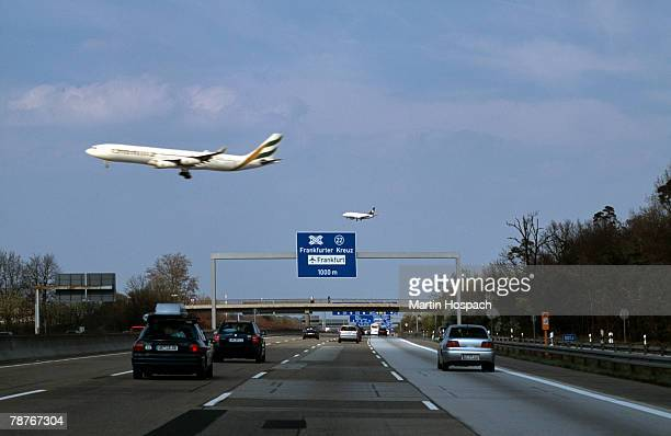 Aeroplanes flying over a motorway in Germany