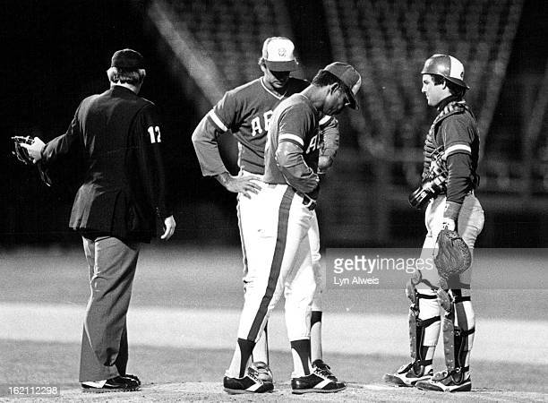 MAY 7 1983 Aeros' Manager Felipe Alou front changes pitchers in the third Rick Ramos and Catcher Tom Wieghaus wait