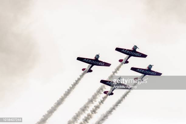 AeroShell Aerobatic Team performs over Lake Michigan during a realtime rehearsal for the 60th Chicago Air and Water Show in Chicago United States on...