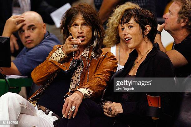 Aerosmith frontman Steven Tyler and girlfriend Erin Brady attend Game Six of the 2008 NBA Finals between the Los Angeles Lakers and the Boston...
