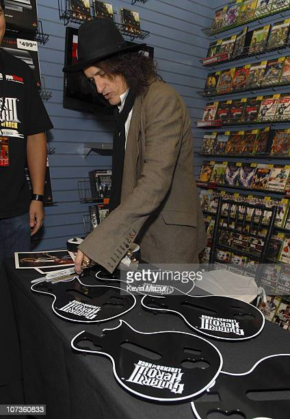 Aerosmith Guitarist Joe Perry helps celebrate the launch of Guitar Hero III Legends of Rock at Game Stop on October 28 2007 in New York City