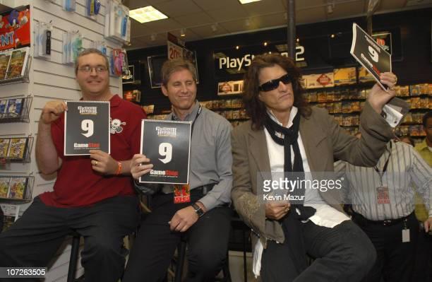 Aerosmith Guitarist Joe Perry judges contest between two Guitar Hero III Legends of Rock players at Game Stop on October 28 2007 in New York City