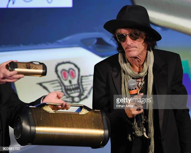 Aerosmith guitarist Joe Perry looks at some speakers in his Monster collection during a Monster Inc press event for CES 2018 at the Mandalay Bay...