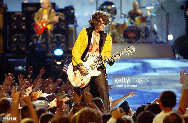 Aerosmith guitarist Joe Perry performs on the 2003 NFL Kickoff Live from the National Mall September 4 2003 in Washington DC Thousands of American...