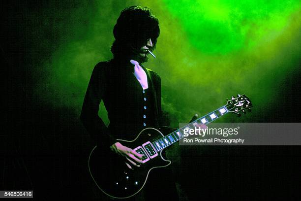 Aerosmith guitarist Joe Perry performs onstage in 1975
