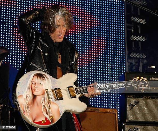 Aerosmith guitarist Joe Perry plays a Gibson guitar with an image of his wife Billie Perry on it as he performs during a concert at the Bare Pool...