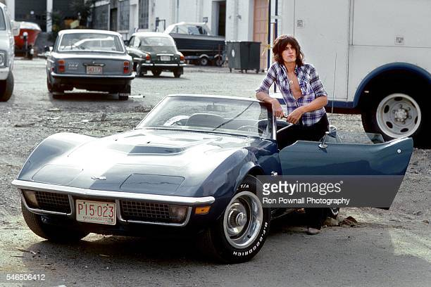 Aerosmith guitarist Joe Perry poses for a portrait with his 1975 Corvette Stingray on August 10 1975 in Waltham Massachusetts