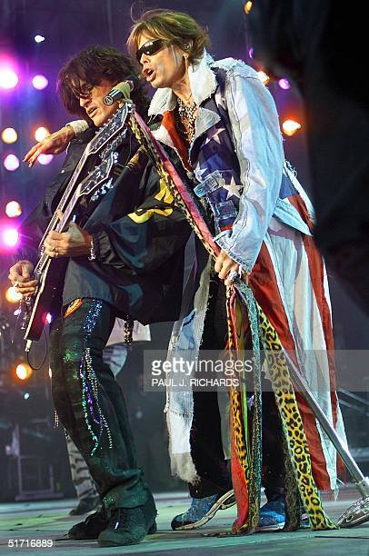Aerosmith lead guitar player Joe Perry and lead singer Steven Tyler perform in the United We Stand concert 21 October 2001 at RFK Stadium in...
