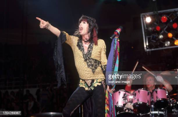 Aerosmith lead singer Steven Tyler and drummer Joey Kramer perform during the band's Permanent Vacation Tour on December 5 at the Joe Louis Arena in...