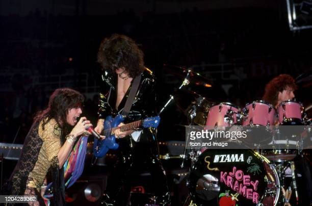 Aerosmith lead singer Steven Tyler lead guitarist Joe Perry and drummer Joey Kramer perform during the band's Permanent Vacation Tour on December 5...