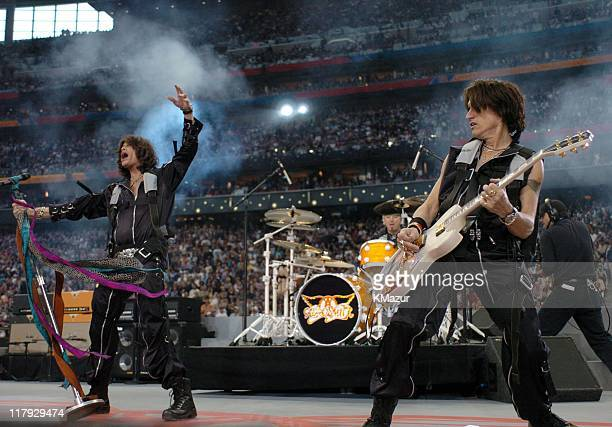 Aerosmith perform during the Super Bowl XXXVIII pregame show entitled 'Welcome to Houston The Spirit of Texas'