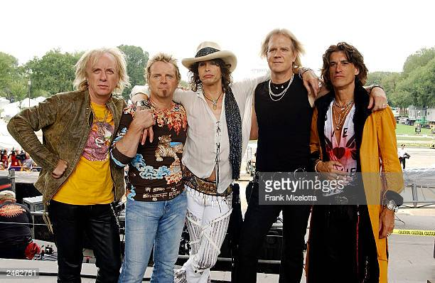 Aerosmith singer Steven Tyler performs on the 2003 NFL Kickoff Live from the National Mall September 4 2003 in Washington DC Thousands of American...