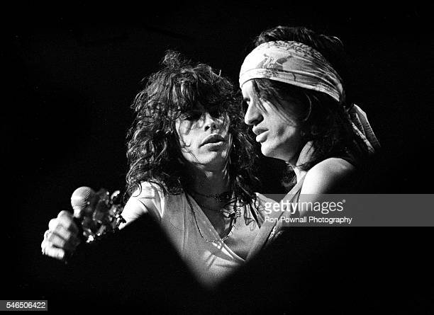 Aerosmith singer Steven Tyler with guitarist Joe Perry perform onstage at the Boston Garden on December 17 1974 in Boston Massachusetts