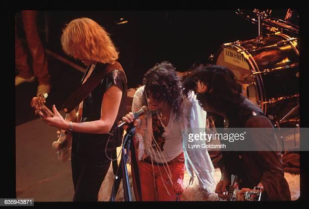 Aerosmith's guitarists jam next to singer Steven Tyler