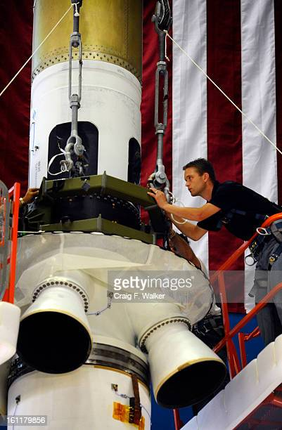 Aerospace technician Joe Krampert and members of the Assembly Test and Launch Operations Team prepare to move the Orion MultiPurpose Crew Vehicle and...
