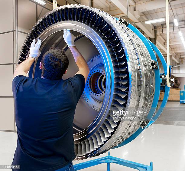 Aerospace technician working in factory