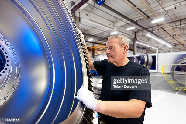 aerospace technician working in factory - atomic imagery stock pictures, royalty-free photos & images