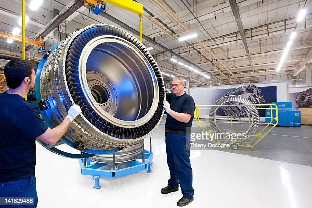 Aerospace technicians working in factory