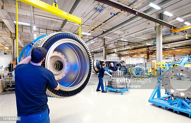 Aerospace technicians working on aircraft engine