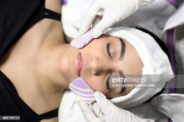 Aesthetic Doctor Performs Face Cleansing On Young Patient