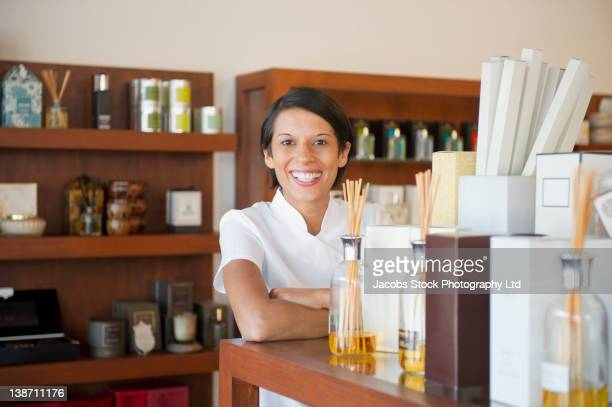 aesthetician standing in beauty product store - aromatherapy stock pictures, royalty-free photos & images