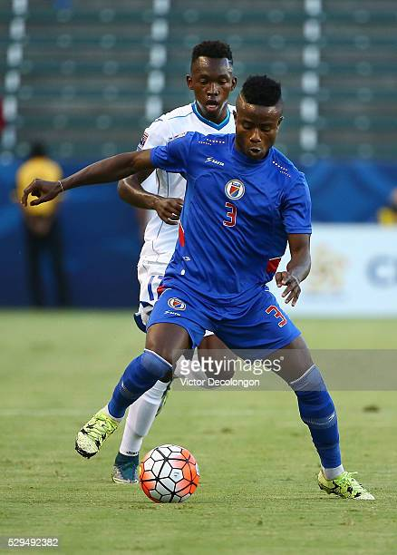 Aex Jr Christian of Haiti protects the ball from Alberth Josue Elis Martinez of Honduras during the 2015 CONCACAF Olympic Qualifying Group B match at...
