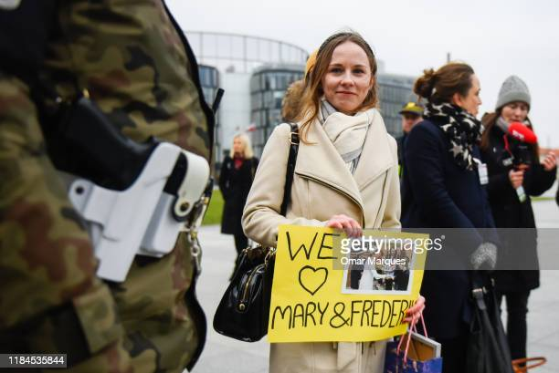 Af an of Crown Prince Frederik of Denmark and Crown Princess Mary of Denmark holds a banner next to the Tomb of Unknown Soldiers on November 25 2019...