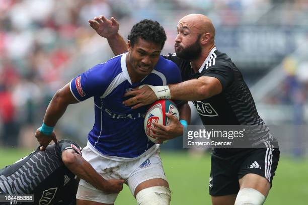Afa Aiono of Samoa is tackled by D J Forbes of New Zealand during the Cup Quarter Final match between New Zealand and Samoa during day three of the...