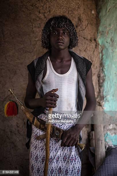 Afar boy with the typical dagger Afar, to the market Assayta, Danakil depression