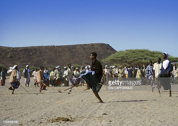 Afar dance for wedding in Eritrea on May 26, 2005 - An Afar wedding in Danakil coast. The girl is hidden in a tent. The groom comes to the village...