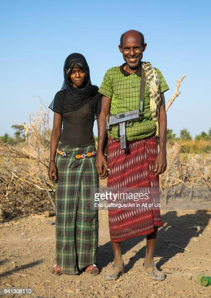 Afar tribe husband with his young second wife on January 21 2017 in Chifra Ethiopia