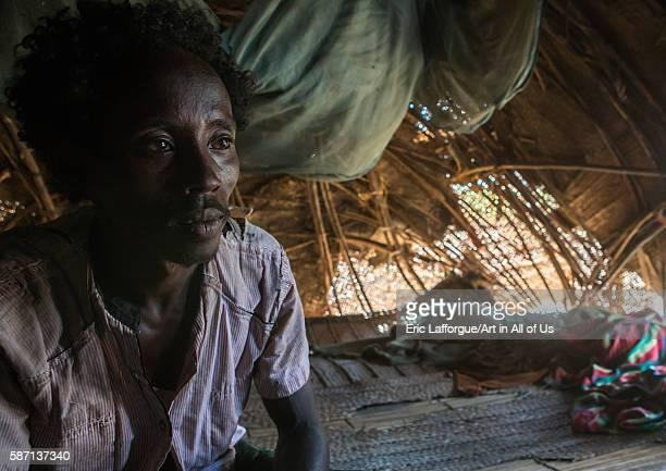 Afar tribe man inside his hut afar region afambo Ethiopia on March 1 2016 in Afambo Ethiopia