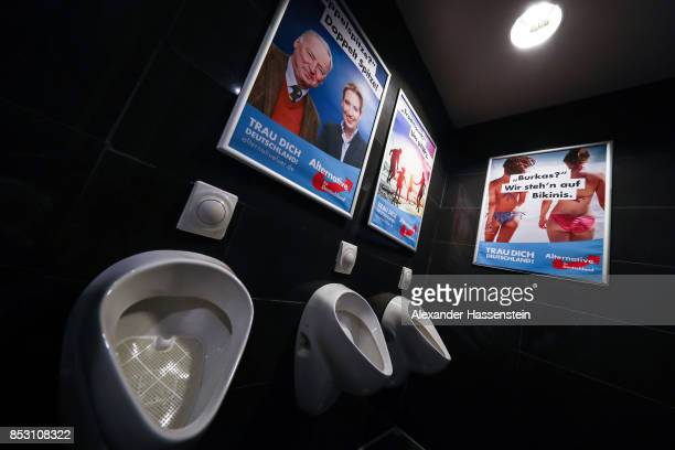 AfD Campaign board are displayed at the male cloakroom after reaching a betterthanexpected 13% and third place finish in German federal elections on...