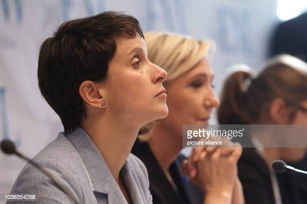 AfD chairwoman Frauke Petry and the chairwoman of the French Front National Marie Le Pen sit during press conference at the congress of the rightwing...