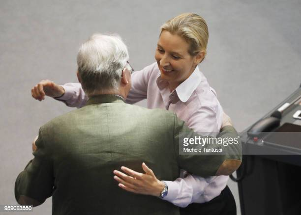 AfD Far Right Party Chairwoman Alice Weidel and her co Chairman Alexander Gauland greets each other after she addressed the Bundestag during debates...