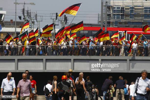 AfD sympathizers wave Germany Flags as they cross a Bridge during the Right Party AfD Demonstration march titled Future Germany on May 27 2018 in...