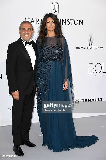 Afef Jnifen and a guest attend the amfAR's 23rd Cinema Against AIDS Gala at Hotel du CapEdenRoc on May 19 2016 in Cap d'Antibes France