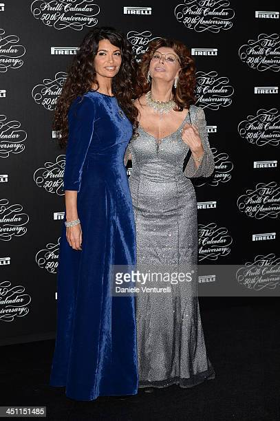 Afef Jnifen and Sophia Loren attend the Pirelli Calendar 50th Anniversary Red Carpet on November 21 2013 in Milan Italy